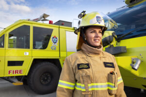 A woman aviation firefighter in ARFFS