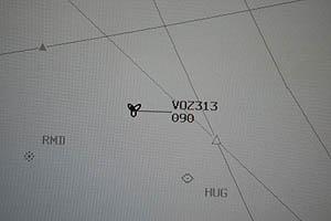 An ADS-B symbol showing a Virgin Australia flight at 9,000 feet.