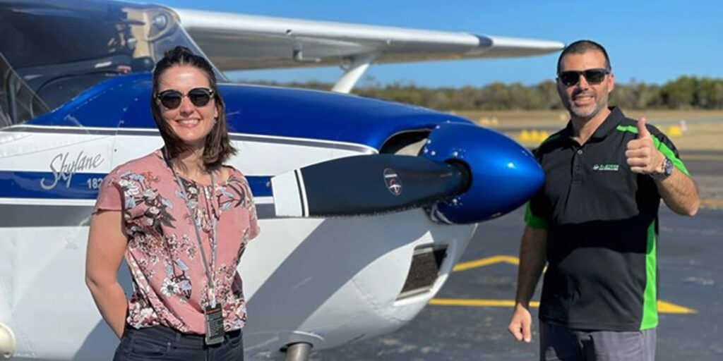 Candice Pearson with flight training instructor