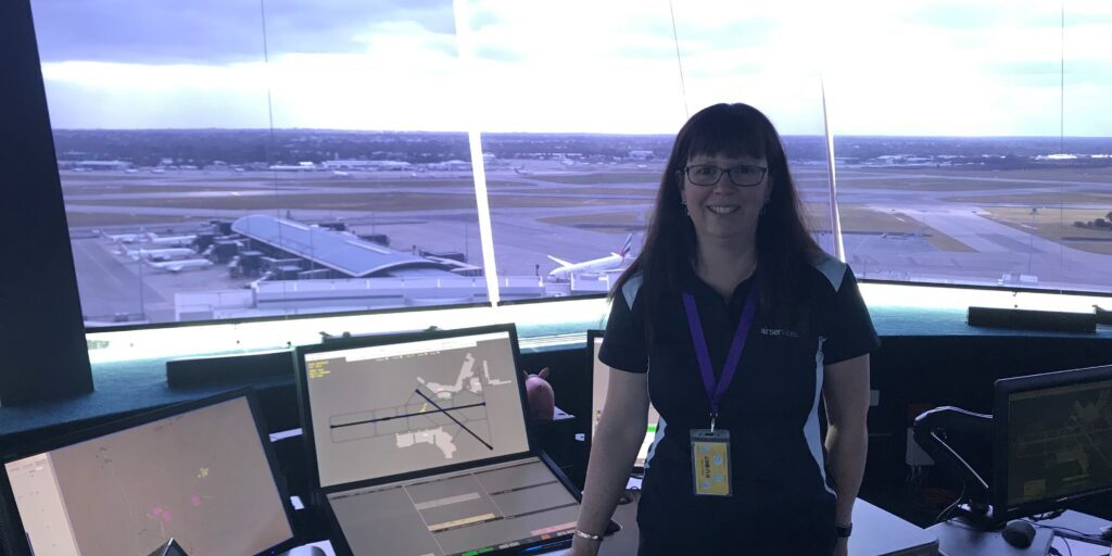Air Traffic Controller Susie McGough stands in Perth ATC Tower